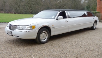 Hire a Hen & Stag Party Limo Lincoln Town Car in white